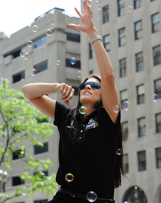 INDIANAPOLIS, IN - MAY 28:  Danica Patrick driver of the #7 Andretti Autosport Dallara Honda tries to catch bubbles during the parade for the 100th Anniversary of the Indianapolis 500 on May 28, 2011 in the streets of Indianapolis, Indiana.  (Photo by Rob