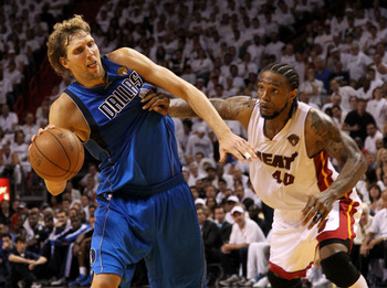 MIAMI, FL - MAY 31:  Dirk Nowitzki #41 of the Dallas Mavericks drives on Udonis Haslem #40 of the Miami Heat in the fourth quarter in Game One of the 2011 NBA Finals at American Airlines Arena on May 31, 2011 in Miami, Florida. NOTE TO USER: User expressl