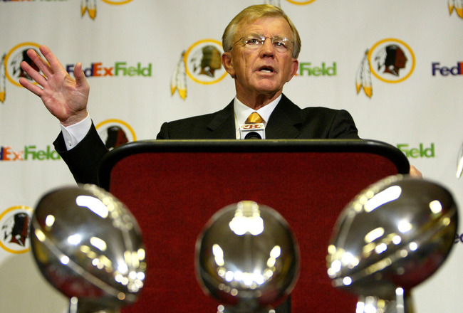 ASHBURN, VA - JANUARY 8:  Joe Gibbs addresses the media as he is announced as the new head coach of the Washington Redskins at a media conference on January 8, 2004 at Redskins Park in Ashburn, Virginia. The Redskins organizations' three Super Bowl Trophi