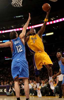 LOS ANGELES, CA - FEBRUARY 10:  Lamar Odom #7 of the Los Angeles Lakers shoots over Nenad Kristic #12 of the Oklahoma City Thunder on February 10, 2009 at Staples Center in Los Angeles, California.   NOTE TO USER: User expressly acknowledges and agrees th