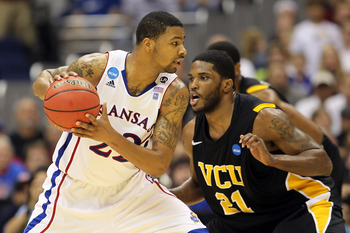 SAN ANTONIO, TX - MARCH 27:  Marcus Morris #22 of the Kansas Jayhawks handles the ball against Jamie Skeen #21 of the Virginia Commonwealth Rams during the southwest regional final of the 2011 NCAA men's basketball tournament at the Alamodome on March 27,