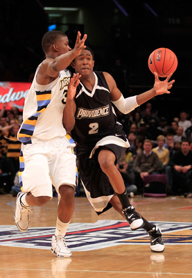 NEW YORK, NY - MARCH 08: Marshon Brooks #2 of the Providence Friars brings the ball up court against Jimmy Butler #33 of the Marquette Golden Eagles during the first round of the 2011 Big East Men's Basketball Tournament presented by American Eagle Outfit