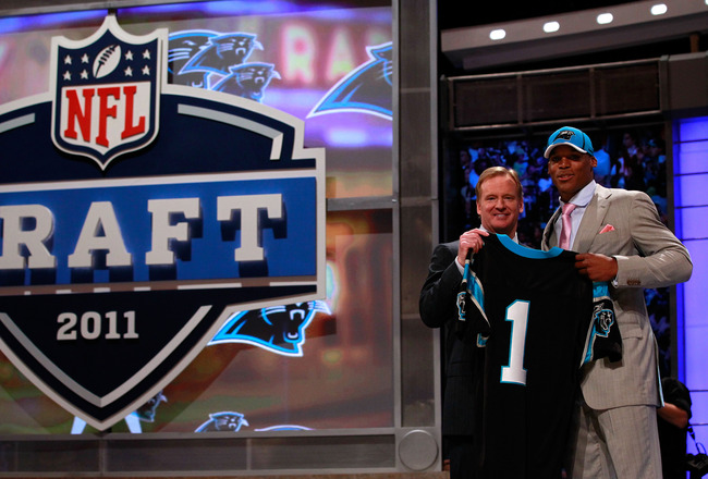 NEW YORK, NY - APRIL 28:  NFL Commissioner Roger Goodell poses for a photo with Carolina Panthers #1 overall pick Cam Newton from Auburn during the 2011 NFL Draft at Radio City Music Hall on April 28, 2011 in New York City.  (Photo by Chris Trotman/Getty