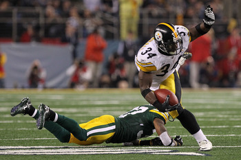 ARLINGTON, TX - FEBRUARY 06:  Rashard Mendenhall #34 of the Pittsburgh Steelers tries to avoid the tackle of Sam Shields #37 of the Green Bay Packers during Super Bowl XLV at Cowboys Stadium on February 6, 2011 in Arlington, Texas.  (Photo by Doug Pensing