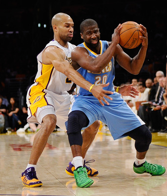 LOS ANGELES, CA - APRIL 03:  Raymond Felton #20 of the Denver Nuggets is pressured by Derek Fisher #2 of the Los Angeles Lakers at Staples Center on April 3, 2011 in Los Angeles, California. NOTE TO USER: User expressly acknowledges and agrees that, by do