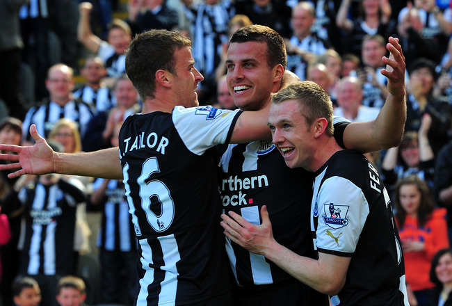 NEWCASTLE UPON TYNE, ENGLAND - MAY 22: Newcastle player Steven Taylor (c) celebrates his goal with Ryan Taylor (l) and Shane Ferguson during the Barclays Premier League game between Newcastle United and West Bromwich Albion at St James' Park on May 22, 20