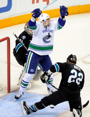 SAN JOSE, CA - MAY 22:  Alex Burrows #14 of the Vancouver Canucks celebrates after scoring from the left wing on a pass through the crease past goaltender Antti Niemi #31 of the San Jose Sharks in the third period in Game Four of the Western Conference Fi