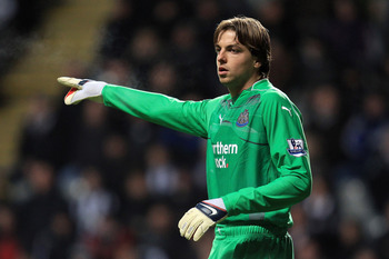 NEWCASTLE UPON TYNE, ENGLAND - DECEMBER 11:  Tim Krul of Newcastle United gestures during the Barclays Premier League match between Newcastle United and Liverpool at St James' Park on December 11, 2010 in Newcastle, England.  (Photo by Mark Thompson/Getty