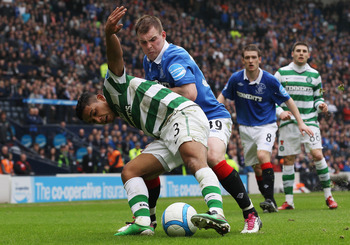 GLASGOW, SCOTLAND - MARCH 20:  Emilio Izaguirre of Celtic tackles Gregg Wylde Rangers during the Co-operative Insurance Cup Final between Celtic and Rangers at Hampden Park on March 20, 2011 in Glasgow, Scotland.  (Photo by Jeff J Mitchell/Getty Images)