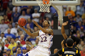 SAN ANTONIO, TX - MARCH 27:  Marcus Morris #22 of the Kansas Jayhawks goes to the basket against the Virginia Commonwealth Rams during the southwest regional final of the 2011 NCAA men's basketball tournament at the Alamodome on March 27, 2011 in San Anto