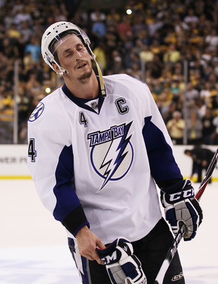 BOSTON, MA - MAY 27:  Vincent Lecavalier #4 of the Tampa Bay Lightning reacts after their 1 to 0 loss to the Boston Bruins in Game Seven of the Eastern Conference Finals during the 2011 NHL Stanley Cup Playoffs at TD Garden on May 27, 2011 in Boston, Mass