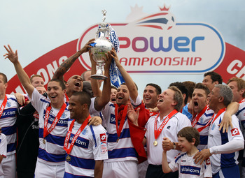 LONDON, ENGLAND - MAY 07:  Queens Park Rangers players celebrates with the trophy after winning the npower Championship match between Queens Park Rangers and Leeds United at Loftus Road on May 7, 2011 in London, England.  (Photo by Ian Walton/Getty Images