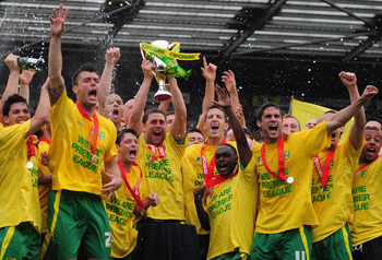 NORWICH, ENGLAND - MAY 07:  Norwich City players celebrate promotion during the npower Championship match between Norwich City and Coventry City at Carrow Road on May 7, 2011 in Norwich, England.  (Photo by Jamie McDonald/Getty Images)