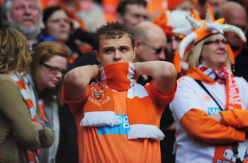 MANCHESTER, ENGLAND - MAY 22:  A Blackpool fan looks dejected as they are relegated during the Barclays Premier League match between Manchester United and Blackpool at Old Trafford on May 22, 2011 in Manchester, England.  (Photo by Shaun Botterill/Getty I