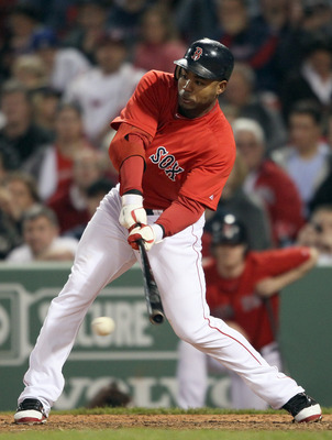 BOSTON, MA - MAY 20:  Carl Crawford #13 of the Boston Red Sox hits a 2RBI single on May 20, 2011 at Fenway Park in Boston, Massachusetts.on May 20, 2011 at Fenway Park in Boston, Massachusetts. The Chicago Cubs and the Boston Red Sox have not played at Fe