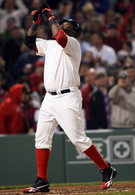 BOSTON, MA - MAY 21:  David Ortiz #34 of the Boston Red Sox celebrates his two run homer in the fourth inning against the Chicago Cubs on May 21, 2011 at Fenway Park in Boston, Massachusetts. Tonight the Chicago Cubs and the Boston Red Sox are wearing rep