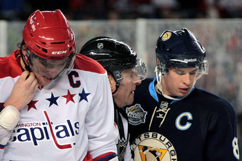 PITTSBURGH, PA - JANUARY 01:  Alex Ovechkin #8 of the Washington Capitals and Sidney Crosby #81 of the Pittsburgh Penguins are seperated by a referee during the 2011 NHL Bridgestone Winter Classic at Heinz Field on January 1, 2011 in Pittsburgh, Pennsylva