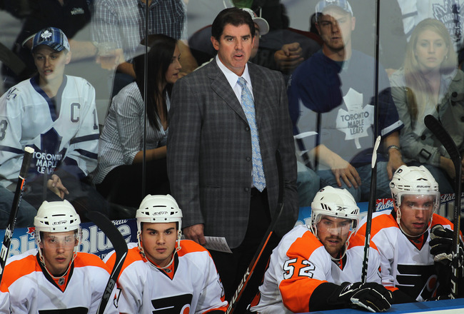 LONDON,ON - SEPTEMBER 23: Head Coach Peter Laviolette of the Philadelphia Flyers watches the play in a pre-season game against the Toronto Maple Leafs on September 23,2010 at the John Labatt Centre in London, Ontario. The Leafs defeated the Flyers 3-2 in