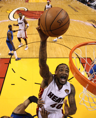 MIAMI, FL - MAY 31:  Udonis Haslem #40 of the Miami Heat goes up for a shot over Tyson Chandler #6 of the Dallas Mavericks in the fourth quarter in Game One of the 2011 NBA Finals at American Airlines Arena on May 31, 2011 in Miami, Florida. NOTE TO USER: