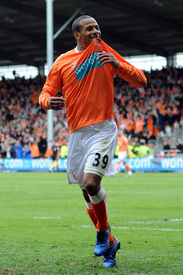 BLACKPOOL, ENGLAND - MAY 14:  DJ Campbell of Blackpool celebrates after scoring his side's third goal during the Barclays Premier League match between Blackpool and Bolton Wanderers at Bloomfield Road on May 14, 2011 in Blackpool, England.  (Photo by Chri