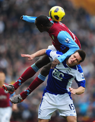 BIRMINGHAM, ENGLAND - OCTOBER 31:  Emile Heskey of Aston Villa climbs all over Scott Dann of Birmingham during the Barclays Premier League match between Aston Villa and Birmingham at Villa Park on October 31, 2010 in London, England.  (Photo by Mike Hewit
