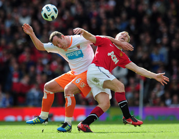 MANCHESTER, ENGLAND - MAY 22:  Charlie Adam of Balckpool battles with Paul Scholes of Manchester United during the Barclays Premier League match between Manchester United and Blackpool at Old Trafford on May 22, 2011 in Manchester, England.  (Photo by Sha