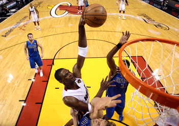 MIAMI, FL - MAY 31:  Chris Bosh #1 of the Miami Heat goes up for a dunk over Dirk Nowitzki #41 of the Dallas Mavericks in the second half in Game One of the 2011 NBA Finals at American Airlines Arena on May 31, 2011 in Miami, Florida. NOTE TO USER: User e