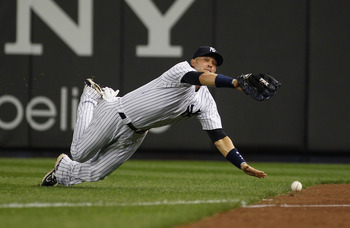 NEW YORK - MAY 20:  Nick Swisher #33 of the New York Yankees dives and misses Justin Turner #2 of the New York Mets (not pictured) ground rule double on May 20, 2011 at Yankee Stadium in the Bronx borough of New York City.  (Photo by Mike Stobe/Getty Imag