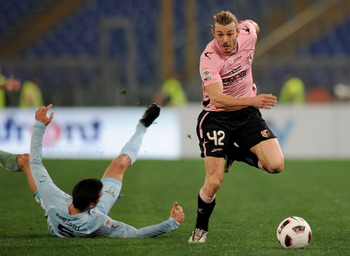 ROME, ITALY - MARCH 06: Federico Balzaretti (R) of Palermo holds off the challenge from Lionel Sebastian Scaloni of Lazio during the Serie A match between SS Lazio and US Citta di Palermo at Stadio Olimpico on March 6, 2011 in Rome, Italy.  (Photo by Tull