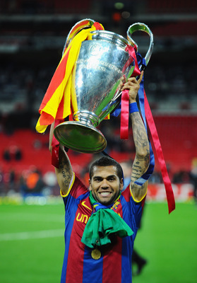 LONDON, ENGLAND - MAY 28:  Daniel Alves of FC Barcelona poses with the trophy after victory in the UEFA Champions League final between FC Barcelona and Manchester United FC at Wembley Stadium on May 28, 2011 in London, England.  (Photo by Clive Mason/Gett