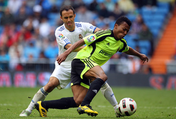MADRID, SPAIN - APRIL 30:  Ricardo Carvalho of Real Madrid battles with Uche of Real Zaragoza during the La Liga match between Real Madrid and Real Zaragoza at Estadio Santiago Bernabeu on April 30, 2011 in Madrid, Spain.  (Photo by Julian Finney/Getty Im