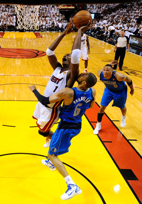 MIAMI, FL - MAY 31:  Chris Bosh #1 of the Miami Heat drives for a shot attempt against Tyson Chandler #6 of the Dallas Mavericks in Game One of the 2011 NBA Finals at American Airlines Arena on May 31, 2011 in Miami, Florida. NOTE TO USER: User expressly