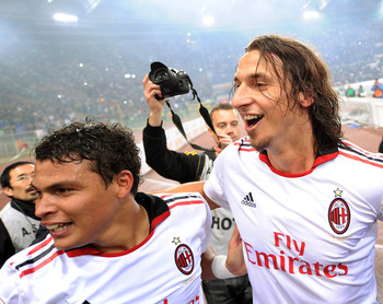 ROME, ITALY - MAY 07:  Thiago Silva and Zlatan Ibrahimovic of Milan celebrate the victory after the Serie A match between AS Roma and AC Milan at Stadio Olimpico on May 7, 2011 in Rome, Italy.  (Photo by Giuseppe Bellini/Getty Images)