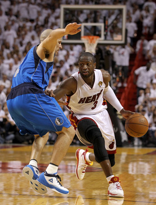 MIAMI, FL - MAY 31:  Dwyane Wade #3 of the Miami Heat drives on Jason Kidd #2 of the Dallas Mavericks in the fourth quarter in Game One of the 2011 NBA Finals at American Airlines Arena on May 31, 2011 in Miami, Florida. NOTE TO USER: User expressly ackno