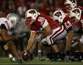 MADISON, WI - OCTOBER 16: Peter Konz #66 of the Wisconsin Badgers prepares to snap the ball to Scott Tolzien #16 against the Ohio State Buckeyes at Camp Randall Stadium on October 16, 2010 in Madison, Wisconsin. Wisconsin defeated Ohio State 31-18. (Photo