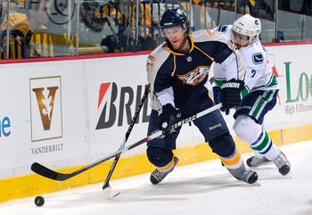 NASHVILLE, TN - MAY 03:  Matt Halischuk #24 of the Nashville Predators skates against Dan Hamhuis #2 of the Vancouver Canucks in Game Three of the Western Conference Semifinals during the 2011 NHL Stanley Cup Playoffs at Bridgestone Arena on May 3, 2011 i