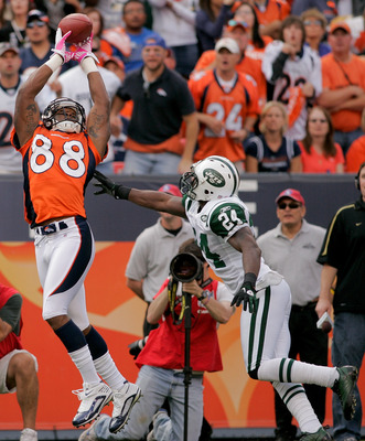 DENVER - OCTOBER 17:  Wide receiver Demaryius Thomas #88 of the Denver Broncos makes a reception for a touchdown against cornerback Darrelle Revis #24 the New York Jets at INVESCO Field at Mile High on October 17, 2010 in Denver, Colorado.  (Photo by Just