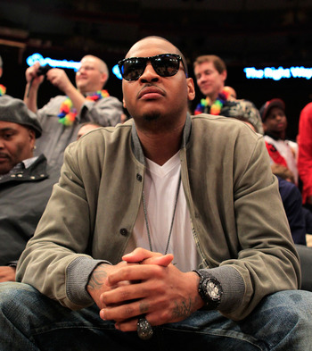 NEW YORK, NY - MARCH 12:  NBA player Carmelo Anthony of the New York Knicks attends the game between the Connecticut Huskies and the Louisville Cardinals during the championship of the 2011 Big East Men's Basketball Tournament presented by American Eagle