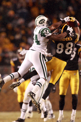 PITTSBURGH, PA - DECEMBER 19:  Darrelle Revis #24 of the New York Jets breaks up a pass intended for Emmanuel Sanders #88 of the Pittsburgh Steelers during their game at Heinz Field on December 19, 2010 in Pittsburgh, Pennsylvania.  (Photo by Karl Walter/