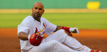 ST. LOUIS, MO - MAY 31: Albert Pujols #5 of the St. Louis Cardinals reacts after being tagged out at first base against the San Francisco Giants at Busch Stadium on May 31, 2011 in St. Louis, Missouri.  (Photo by Dilip Vishwanat/Getty Images)