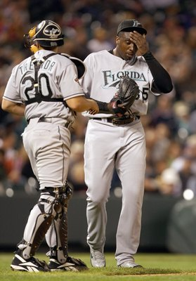 DENVER - SEPTEMBER 14: Starting pitcher Dontrelle Willis #35 of the Florida Marlins reacts with Miguel Olivo #30 against the Colorado Rockies at Coors Field on September 14, 2007 in Denver, Colorado. (Photo by Doug Pensinger/Getty Images)