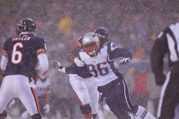 CHICAGO, IL - DECEMBER 12: Jermaine Cunningham #96 of the New England Patriots rushes the quarterback against the Chicago Bears at Soldier Field on December 12, 2010 in Chicago, Illinois.  The Patriots beat the Bears 36-7.  (Photo by Dilip Vishwanat/Getty