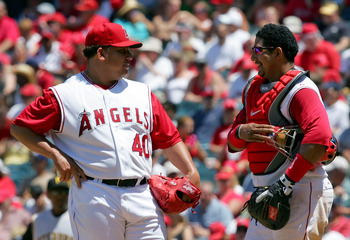 ANAHEIM, CA - JUNE 24:   (L-R) Bartolo Colon #40 and Jose Molina #28 of the Los Angeles Angels of Anaheim meet on the mound during the game against the Pittsburgh Pirates at Angels Stadium on June 24, 2007 in Anaheim, California.  (Photo by Lisa Blumenfel