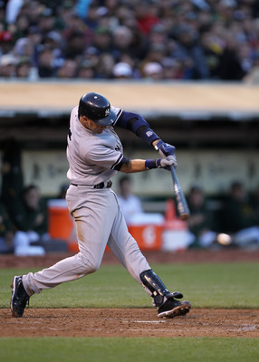 OAKLAND, CA - MAY 31:  Derek Jeter #2 of the New York Yankees hits infield single to load the bases in the fourth inning against the Oakland Athletics at Oakland-Alameda County Coliseum on May 31, 2011 in Oakland, California.  (Photo by Ezra Shaw/Getty Im