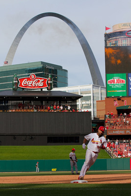 ST. LOUIS, MO - MAY 30: Albert Pujols #5 of the St. Louis Cardinals rounds the bases after hitting a solo home run against the San Francisco Giants at Busch Stadium on May 30, 2011 in St. Louis, Missouri.  (Photo by Dilip Vishwanat/Getty Images)