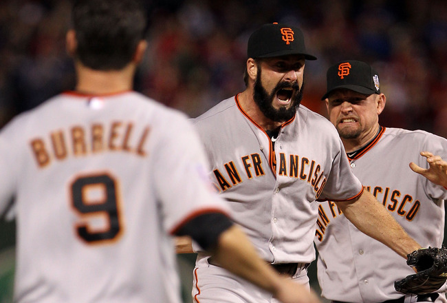 ARLINGTON, TX - NOVEMBER 01:  Brian Wilson (C) #38, Aubrey Huff #17 (R) and Pat Burrell #9 of  the San Francisco Giants celebrate on the field after the Giants won 3-1 against the Texas Rangers in Game Five of the 2010 MLB World Series at Rangers Ballpark