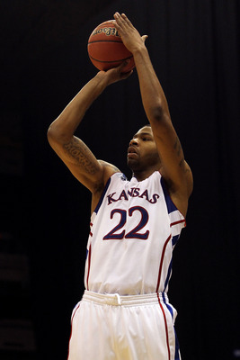 SAN ANTONIO, TX - MARCH 25:  Marcus Morris #22 of the Kansas Jayhawks shoots against the Richmond Spiders during the southwest regional of the 2011 NCAA men's basketball tournament at the Alamodome on March 25, 2011 in San Antonio, Texas. Kansas defeated