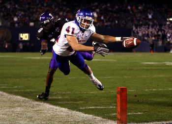 SAN DIEGO, CA - DECEMBER 23:  Runningback Ian Johnson #41 of the Boise State Broncos dives for the endzone pilon against the defense of Cornerback Rafael Priest #10 of TCU during the San Diego County Credit Union Poinsettia Bowl at Qualcomm Stadium on Dec