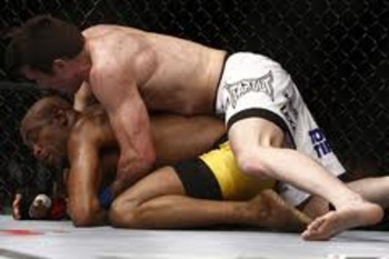 Chael Sonnen controlling Anderson Silva on the ground