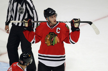 CHICAGO, IL - APRIL 24: Joanthan Toews #19 of the Chicago Blackhawks watches the replay board after a call against the Vancouver Canucks in Game Six of the Western Conference Quarterfinals during the 2011 NHL Stanley Cup Playoffs at the United Center on A